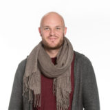 A photo of our teammate Andrej. He's wearing a big scarf.