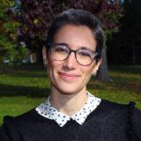 A photo of Susana. She wears glasses.